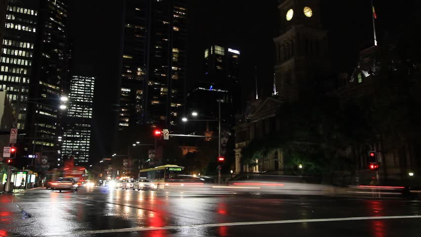 City Street Night Traffic and Pedestrian Time Lapse with people, cars and buses. Night city footage shot on the streets of Sydney Australia but would suit any generic city street scene.