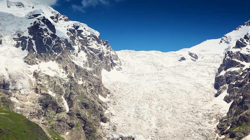 Great view at the foot of Tetnuldi glacier, Chkhutnieri pass. Upper Svaneti, Georgia, Europe. The main Caucasus ridge. Beauty world. HD video (High Definition)