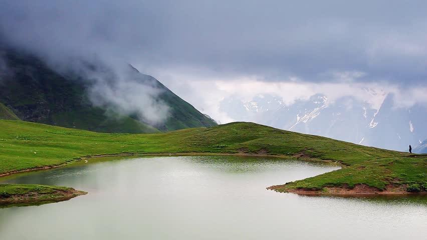 The majestic green hills in foggy weather. Koruldi Lakes, Upper Svaneti, Georgia, Europe. The main Caucasus ridge. Dramatic unusual scene. Beauty world. HD video (High Definition)