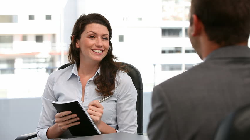 Businesswoman doing an interview in an office