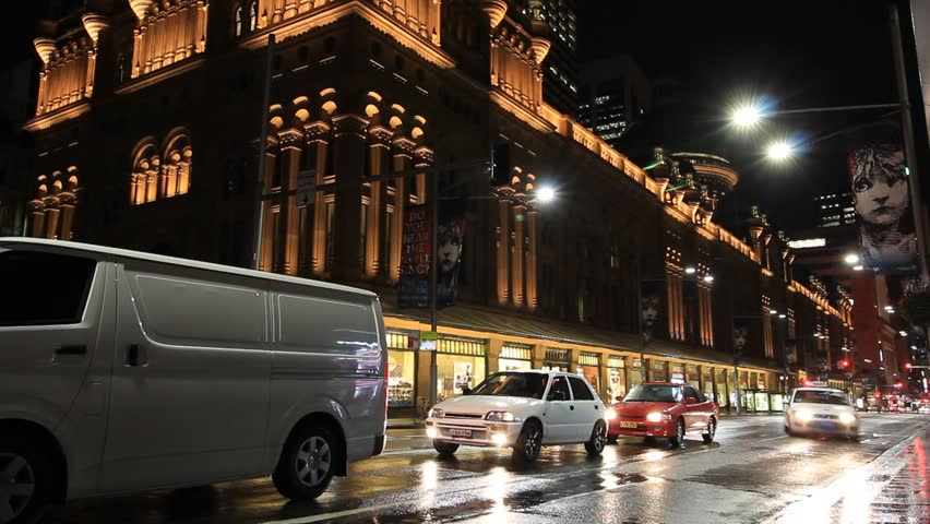 SYDNEY CITY, AUSTRALIA - MARCH 23, 2015: City Street Night Traffic Commuter and Pedestrian Time Lapse with slow shutter. Streets of Sydney Australia but would suit any generic city street scene.