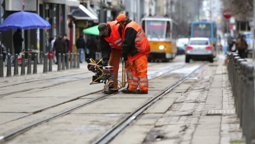 Sofia, Bulgaria - April 7, 2015: Tram road workers are repairing the tram tracks on the tram road.