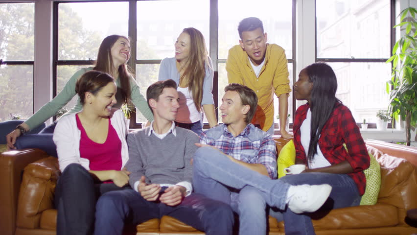 4k portrait of cheerful casual group of young friends for Hanging groups of pictures