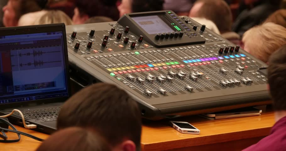 sound engineer using a mixing desk in the concert stock