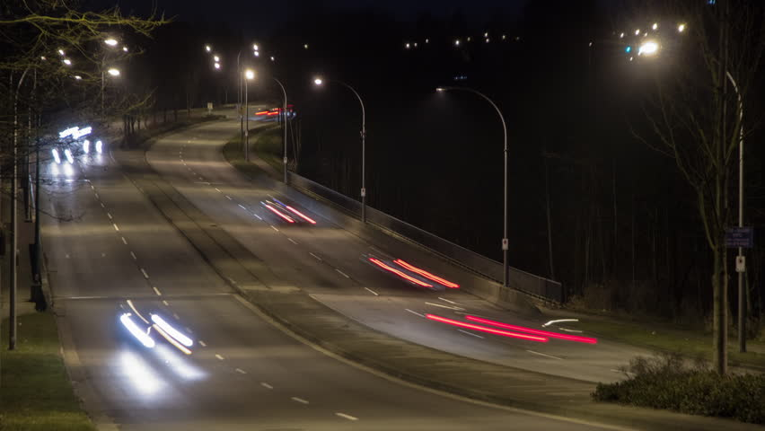 Time lapse of busy traffic uphill and downhill in the city