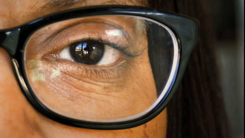 African American black woman eye with glasses extreme close up