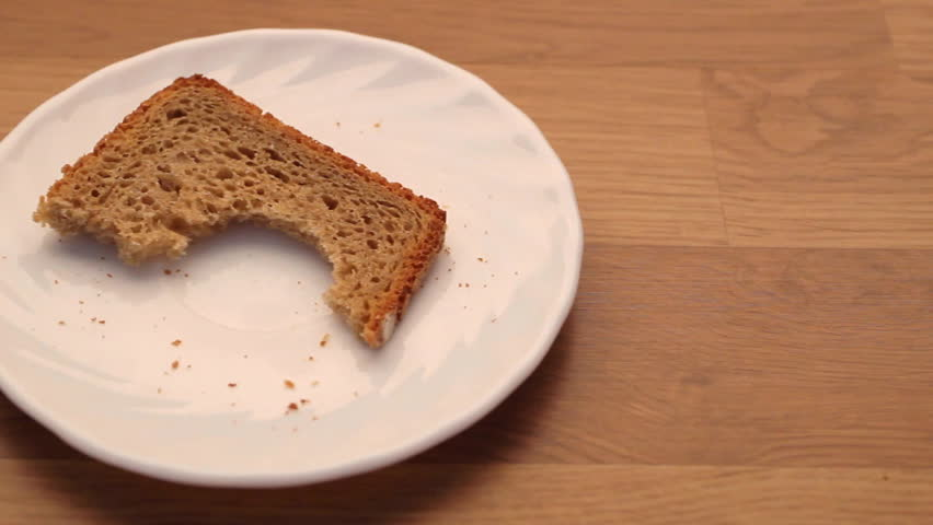 Two Slices Of Bread On A Plate Stock Footage Video 6575690 ...