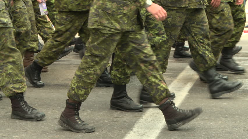 Close up shot of the feet of uniformed soldiers in a public parade