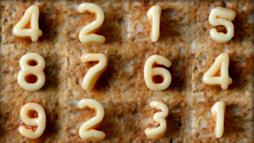 number sequence made from spaghetti pasta letters in tomato sauce on toast - HD stock video clip