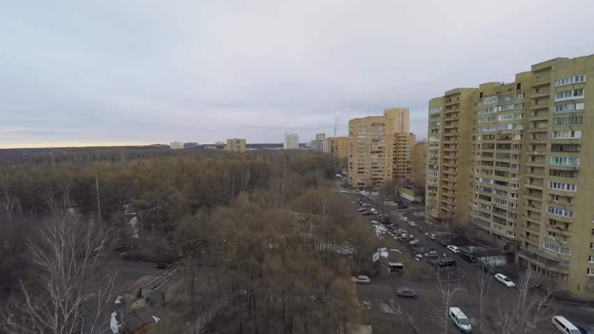 City outskirts with car traffic near national park on Elk island in Moscow at spring cloudy day. Aerial view - HD stock footage clip