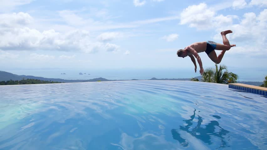 Young Man Jumping In Endless Pool Outdoors Slow Motion