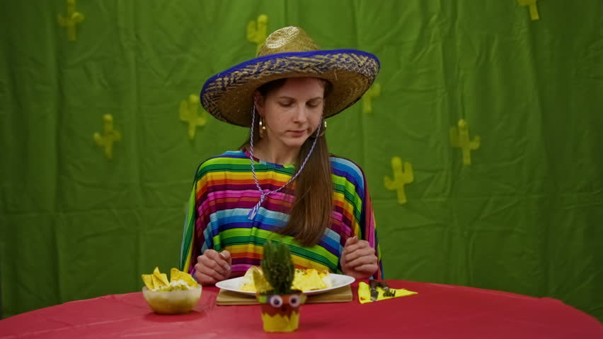 Woman With Sombrero Eating Tortilla Chips. Woman In ...  Woman With Somb...