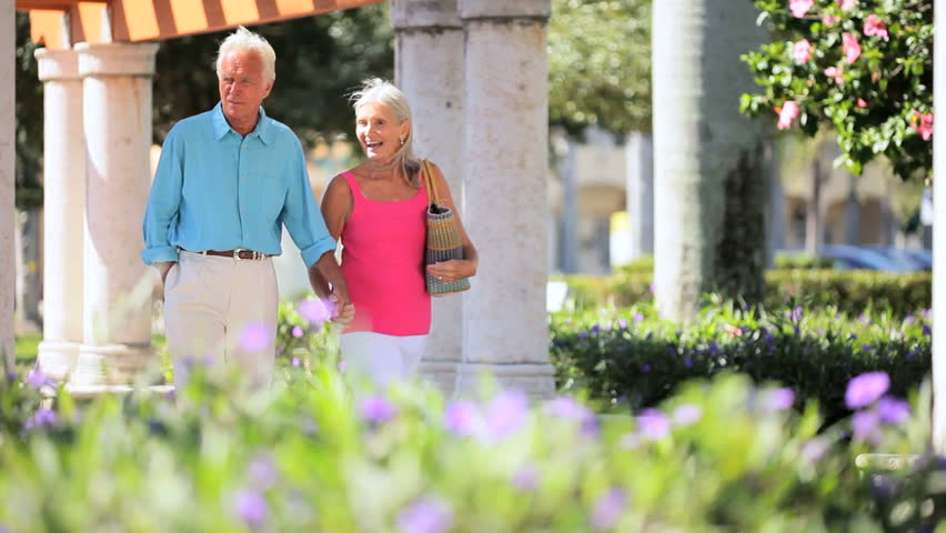 Senior couple enjoying a leisure day at an outdoor mall - HD stock footage clip