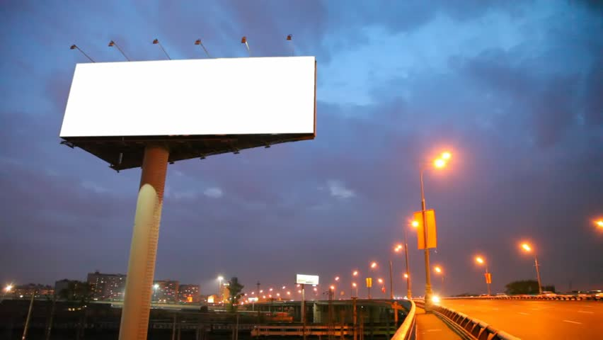 night bridge in city with moving cars and empty billboard