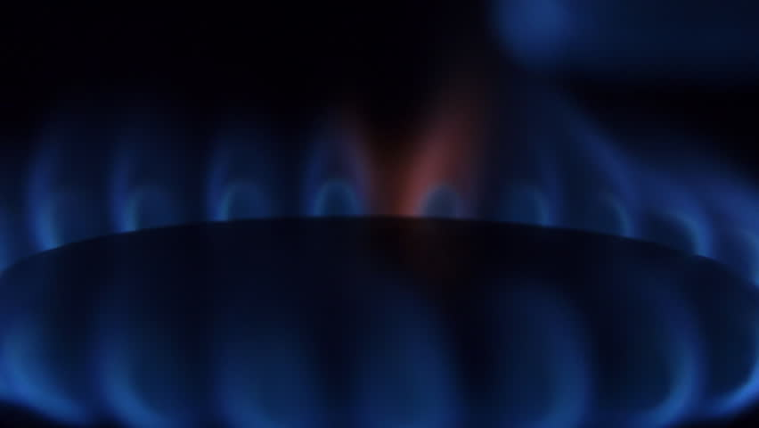 Natural gas burn in stove burner. Rotating gas burner. The camera moves around. Several gas burners in the frame. Closeup - HD stock footage clip