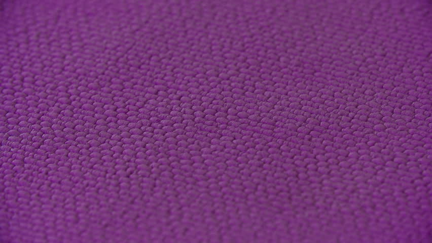 Extreme close up of yoga mat texture and female hand leaning on it